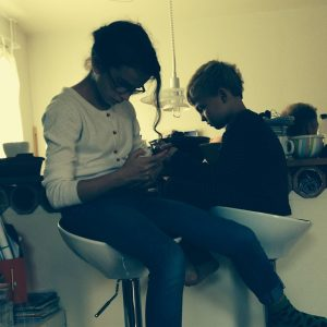 Our lead actors are taking a break from filming to catch up with their social media... Kids today!
